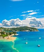 view of luxury resort and bay of Cote d'Azur. Villefranche by Nice french riviera. turquoise sea and blue sky poster