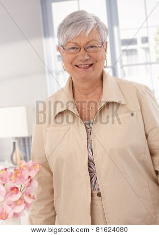 Portrait of happy smiling elderly lady, looking at camera.
