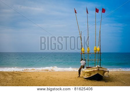 An Old Man Sits On His Boat Looking Out To Sea