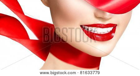 Beauty woman with perfect smile. Beautiful Model Girl with red lips and blowing red silk scarf isolated on white background. Teeth whitening. Holiday make up, perfect skin