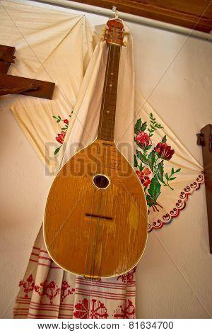 Tamburica (tambourica)- Croatian traditional music instrument on the wall poster
