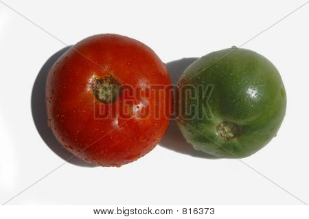 A red and green tomato isolated on a back background