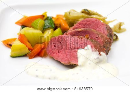 wildebeast steak with grilled vegetables