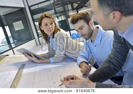 Team of architects working on construction project