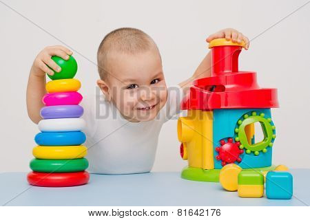 Child playing with educational cup toys.