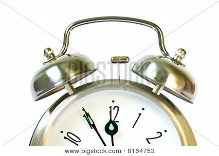 Classical Retro Ring Clock At White Background