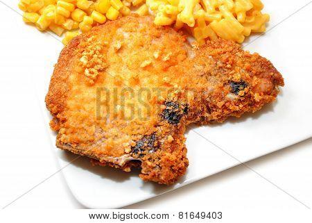 Crispy Baked Breaded Porkchop Served On A Plate