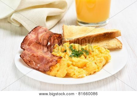 Breakfast With Scrambled Eggs And Bacon