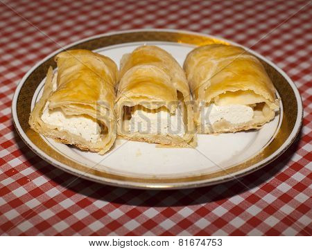 Cottage Cheese Strudel On Checkered Tablecloth