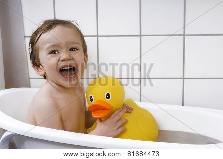 Cute Toddler Playing In A Bathtub