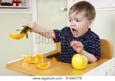 Small Boy Playing With His Fruit