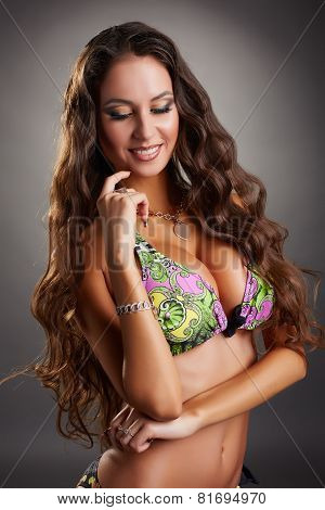 Portrait of coquettish woman in stylish swimsuit