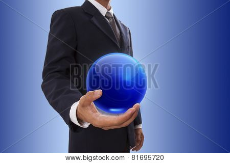 Businessman hand holding blue crystal Ball.