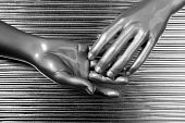 hands together futuristic robot silver steel over gray background poster