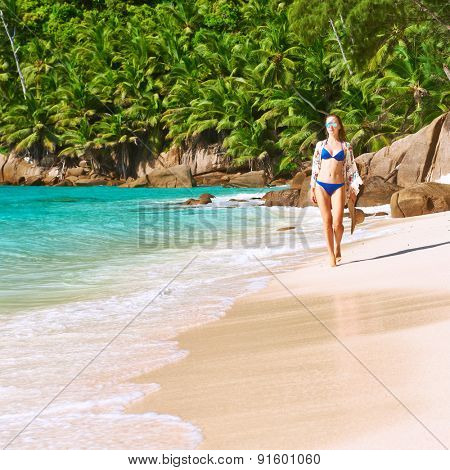Woman with sarong on beach Anse Intendance at Seychelles, Mahe poster