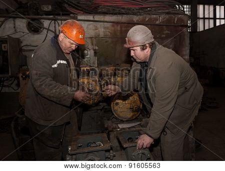 Donetsk, Ukraine - February, 20, 2013: Locksmiths Repair Mining Equipment. Mine Southern - Donbass