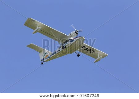 Aeroprakt A-24 Viking hydroplane on the blue sky background
