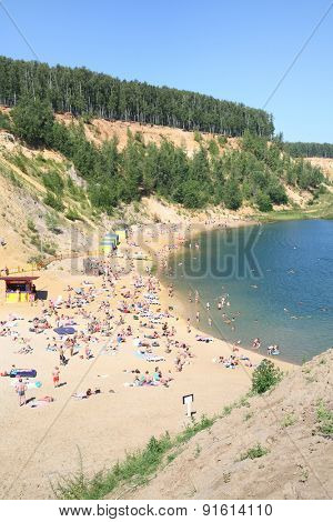 LYUBERTSY, RUSSIA - MAY 23, 2014: Sandy beach with lots of people on the shores of the Lyubertsy career