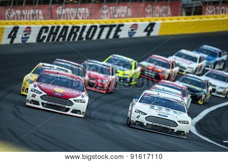 Concord, NC - May 24, 2015:  Joey Logano (22) and Brad Keselowski (2) bring the field out of turn 4 for a start during the Coca-Cola 600 at Charlotte Motor Speedway in Concord, NC.