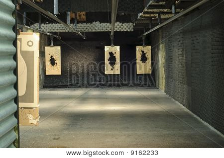 an indoor shooting range at a police dept. poster