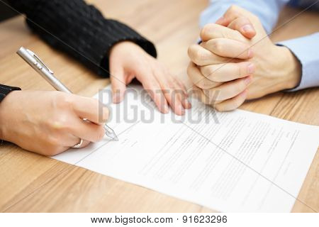 Man  With His Hands Clasped Is Waiting Woman To Sign The Contract