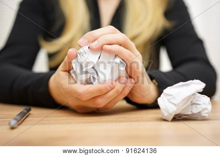 Hands Of Woman Crumple Sheets Of Paper At The Table