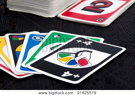 Uno card game on black table