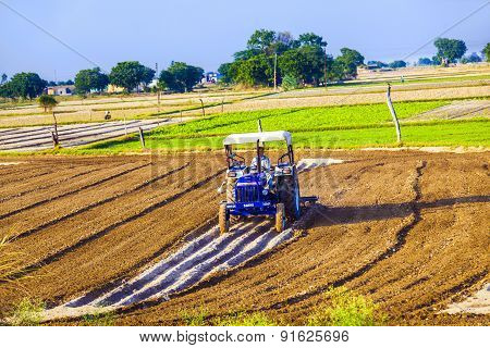Tractor Plows The Field