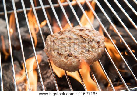 Minced Pork On Grill With Dancing Flames Cooked.