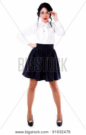 Beautiful young woman in a white blouse and a black skirt isolated over white background poster