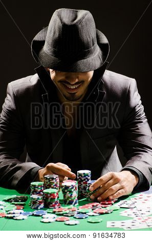 Man playing in dark casino