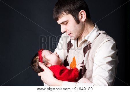 Young father holding his baby girl
