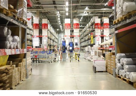 MOSCOW - MAY 21, 2014: Buyers seek out goods in stock self service in a shopping center Ikea in Moscow