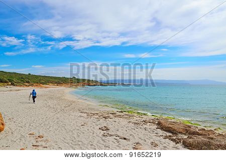 Photographer With Tripod Walking In Le Bombarde Beach