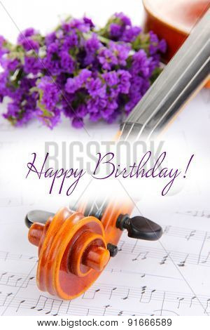 Classical violin  with flowers on notes background