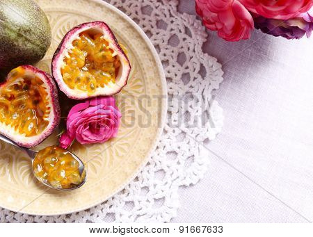Passion fruit on plate on color wooden background poster