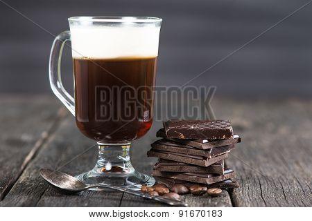 alcoholic irish coffee with dark chocolate and caffee beans poster