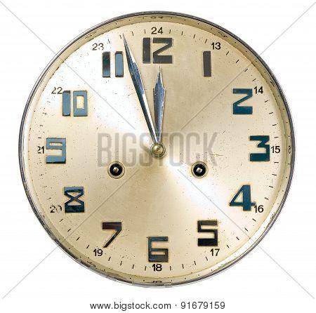 Golden watch is showing almost  twelve o'clock