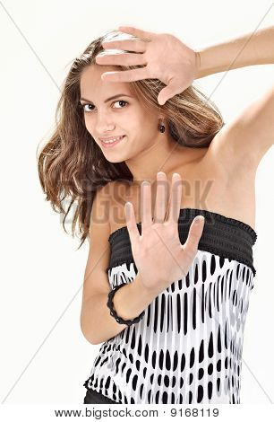 Young Pretty Lady With Long Hairs Defending With Hands Studio Portrait On White