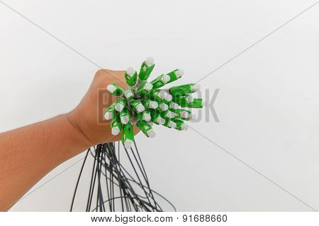 A group head connector fiber optic green color in hand on white background.Fiber Optics connectors.