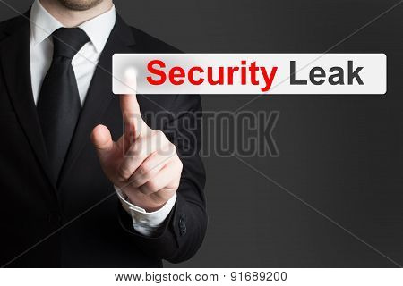Businessman Pushing Touchscreen Security Leak