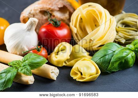 Selection Of Italian Tipical Food On Black Background