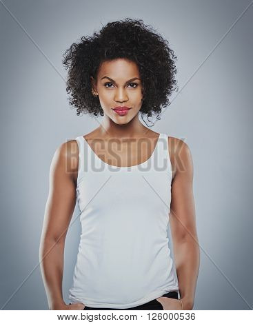 Pretty Grinning Woman With Thumbs In Pockets