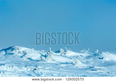 Winter morning hill with ice on slope.
