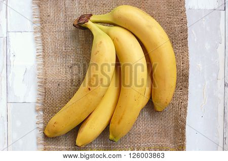 Bananas On The Gunny Cloth And Wooden Background