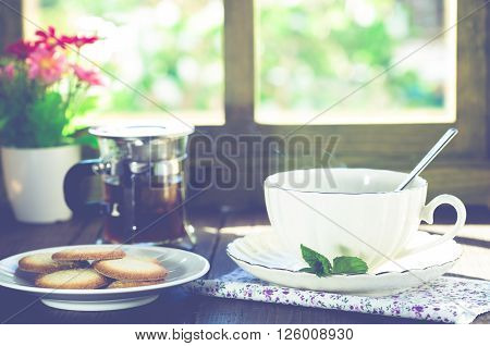 Cup of hot tea with delicious cookies selected