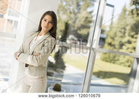 Modern businesswoman standing alone in the office