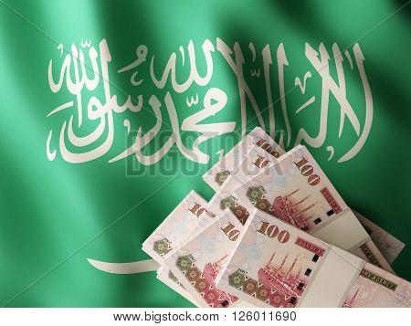 Saudi riyal banknote bundles on textile textured Saudi flag. 3d rendering.