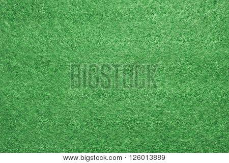 Detail of a green felt texture .