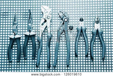 Hand Tools Pliers nippers Set on mat blue colored
